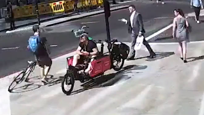 Police are hunting a 'road rage' cyclist after a pedestrian was attacked