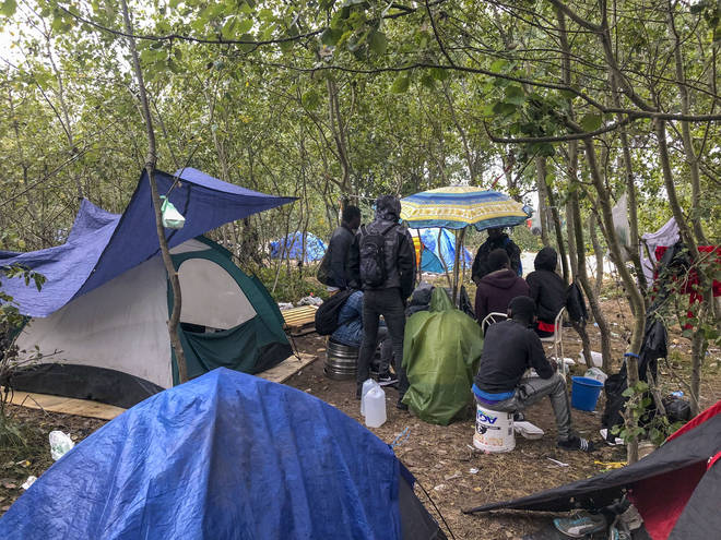 Tents near Calais, France where migrants seeking to get to the UK have set up camps again after being raided by French police.