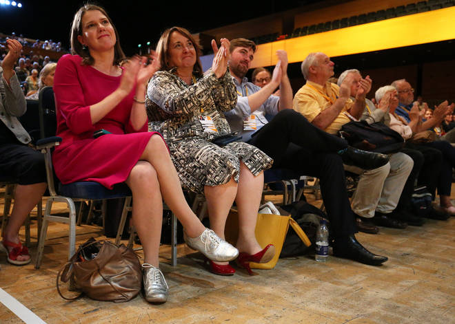 Jo Swinson (far left) applauding during the Liberal Democrats autumn conference at the Bournemouth International Centre in Bournemouth.