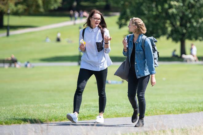 People enjoying the sunshine in Primrose Hill, London.