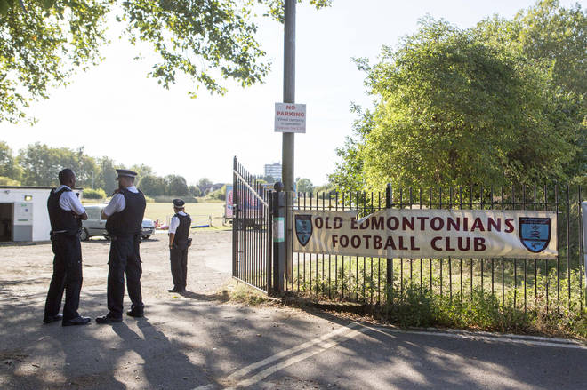 Police officers outside Old Edmontonians Football Club in Jubilee Park, Edmonton, following the fatal stabbing of a 29-year-old man.