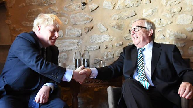 Boris Johnson shakes hands with Jean-Claude Juncker as the pair meet in Luxembourg