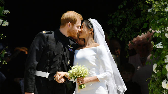 The Duke and Duchess of Sussex share a kiss as they leave the chapel.