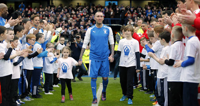 Fernando Ricksen walks out to greet the crowd before his tribute match at the Ibrox Stadium.
