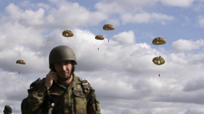 Parachutist jump from a plane near Groesbeek, Netherlands, Thursday, Sept. 19, 2019, as part of commemorations marking the 75th anniversary of Operation Market Garden,