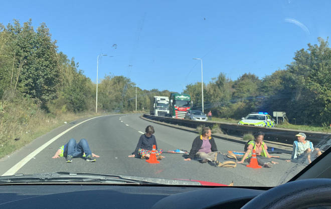 Some protesters superglued themselves to the roads in a bid to block traffic