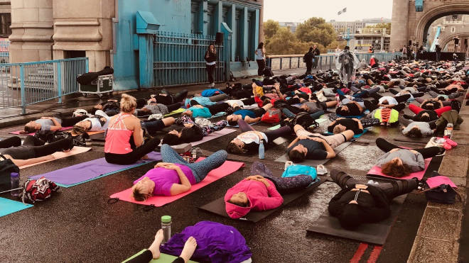 People took to Tower Bridge for a yoga session on the road