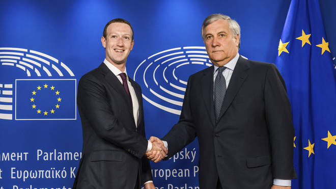 Mark Zuckerberg shakes hands with the President of the European Parliament Antonio Tajani ahead of his testimony in Brussels.
