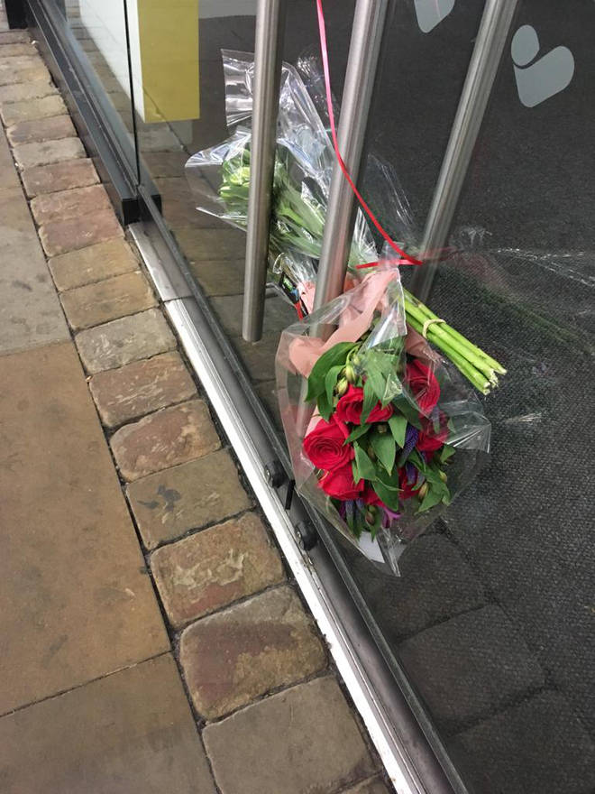 Flowers were left outside the branch