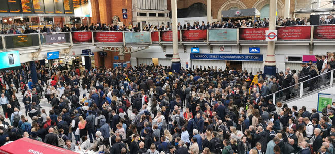 Liverpool Street station is crowded and experiencing flooding