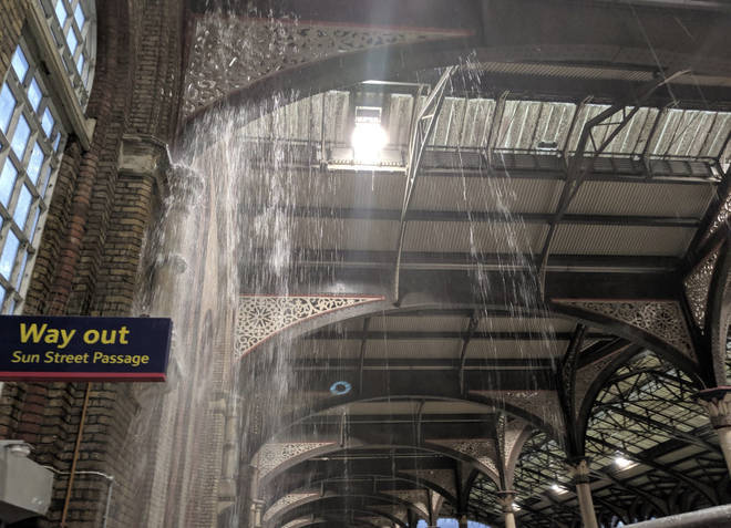 Rainwater pours in through the ceiling at Liverpool Street