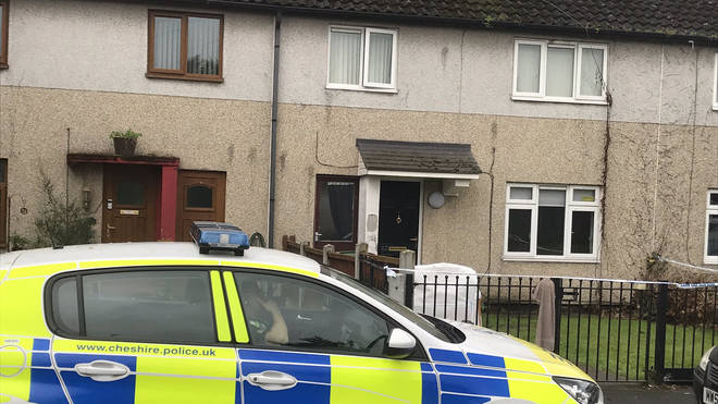 The woman was found in a 'serious condition' at the house on Graham Road