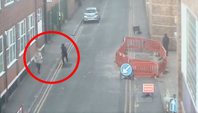 CCTV shows the woman being chased on her way to work