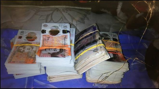 A photos of the stolen cash, which were found on Gica-Fanica Radu's phone.