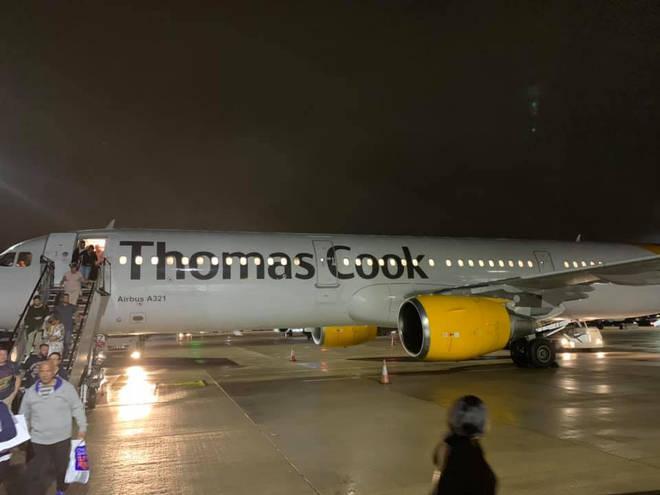 Passengers disembark the the ZT1155 Thomas Cook aircraft