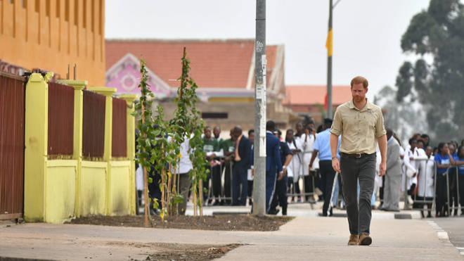 Prince Harry walks down Princess Diana Street in Huambo