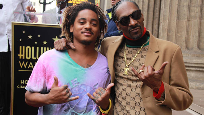 Snoop Dogg and the baby's father Corde Broadus pictured together in 2018