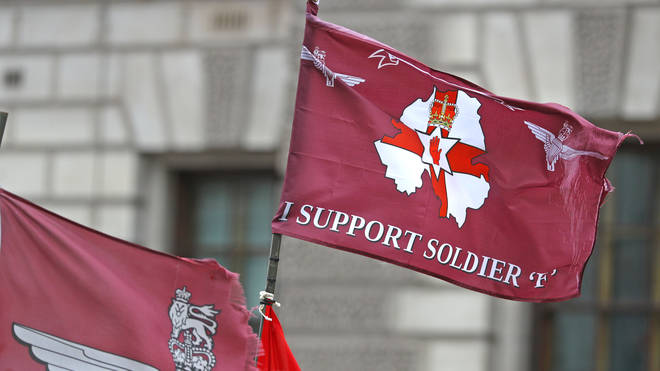 Protesters brandished flags and clothing supporting Soldier F