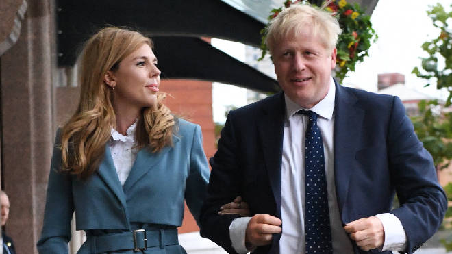 Boris Johnson and his Partner Carrie Symonds arrive at the Tory Party Conference in Manchester