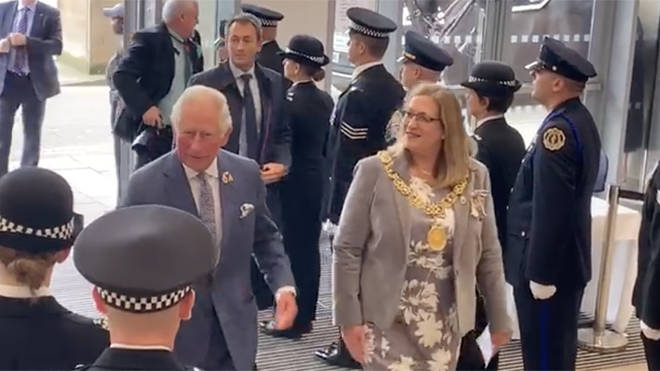 Prince Charles greets police at the service in Glasgow