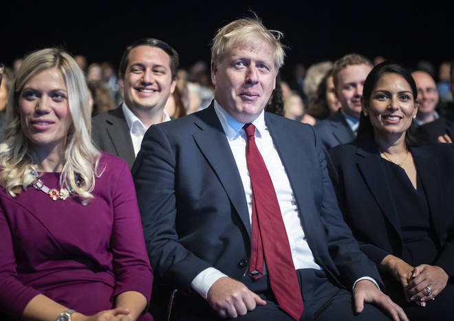 The PM Boris Johnson denies groping a female journalist