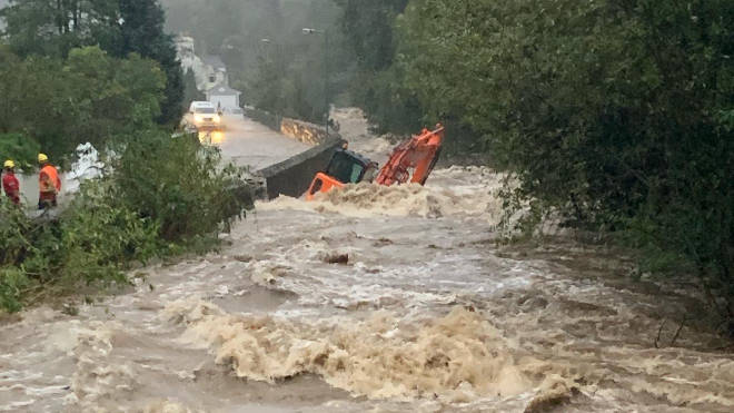 Vehicles, including a digger were washed away