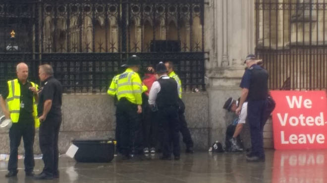 Police sprang into action after a man allegedly doused himself in petrol outside the Houses of Parliament