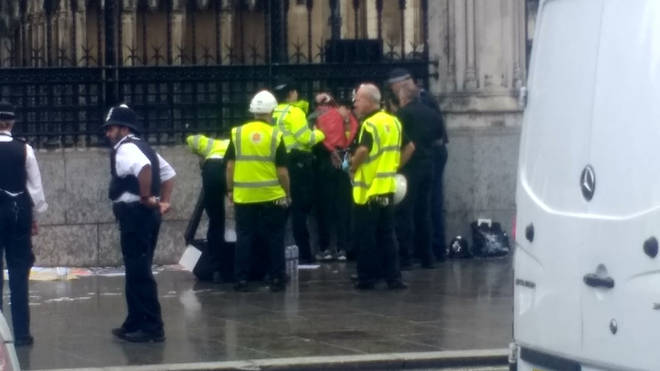 The man is being treated by the Ambulance