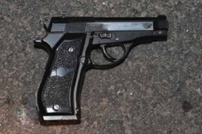Police searched the crime network's silver Vauxhall and identified a black handgun