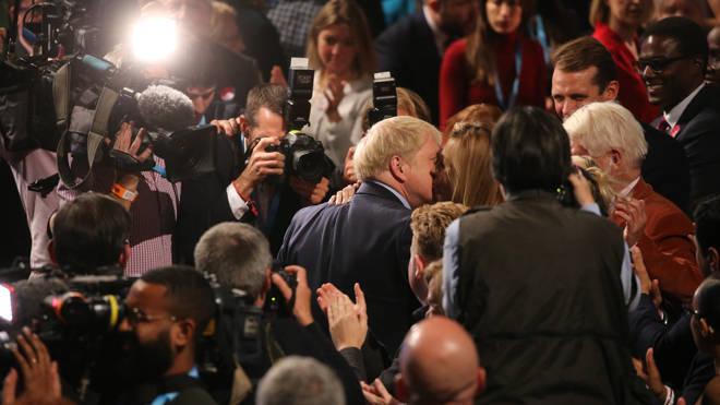 Boris Johnson kisses his girlfriend Carrie Symonds after his speech
