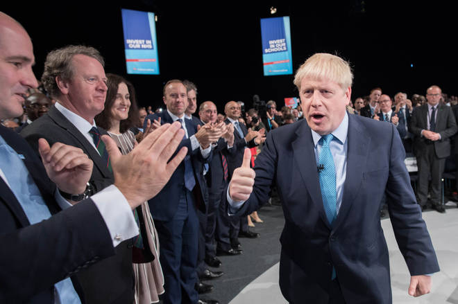 Boris Johnson gave a thumbs up as he left the stage after delivering his speech during the Conservative Party Conference at the Manchester Convention Centre