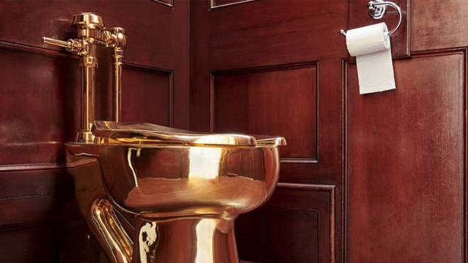 The gold toilet designed by Italian artist Maurizio Cattelan was stolen from Blenheim Palace in September