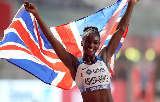 Dina Asher-Smith celebrates as she wins gold in the women's 200m final at Doha