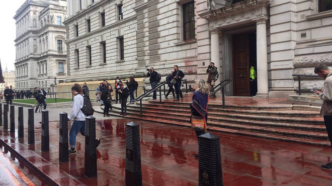 The Treasury building in Whitehall has been doused in fake blood