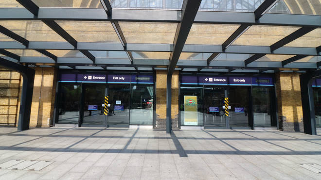 London King's Cross has been evacuated after football fans set off smoke flares in the station