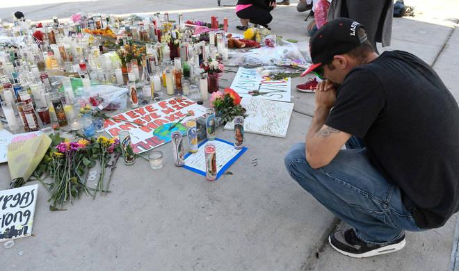 A man prays by a makeshift memorial along Las Vegas Blvd in October 2017