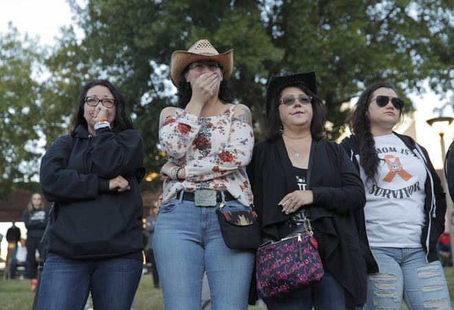 Mourners attend a ceremony on Tuesday, Oct. 1, 2019, on the anniversary of the mass shooting two years earlier