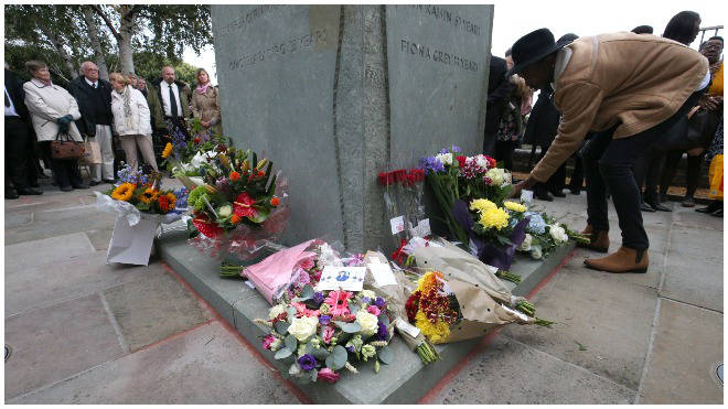 Families of the victims and survivors laid flowers to remember those who died in the disaster