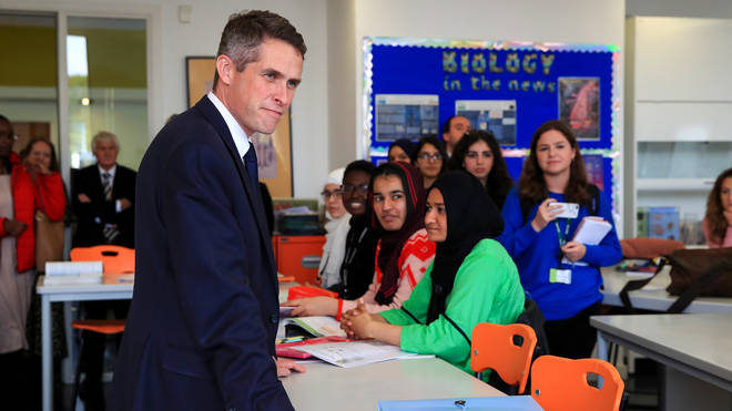 Education Secretary Gavin Williamson talks to students of a biology lesson during a visit to Trafford College