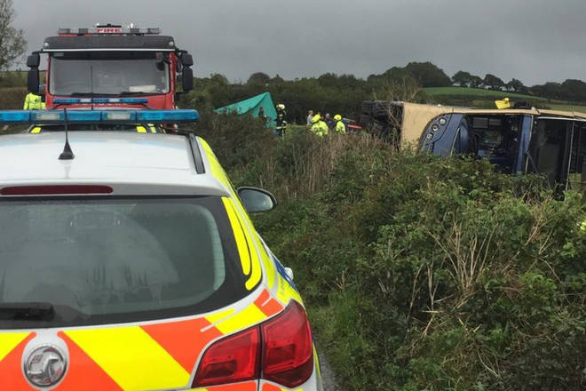 Emergency services are responding to a bus crash near Totnes