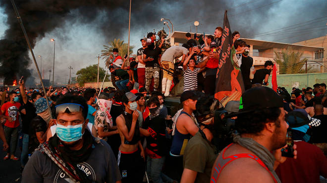 Protesters torched an armoured vehicle in Baghdad