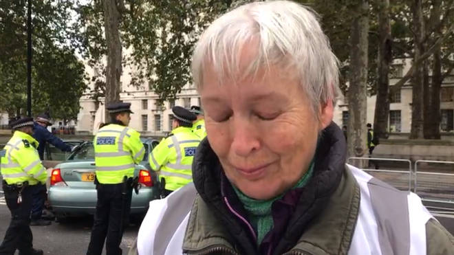 A tearful Extinction Rebellion protester