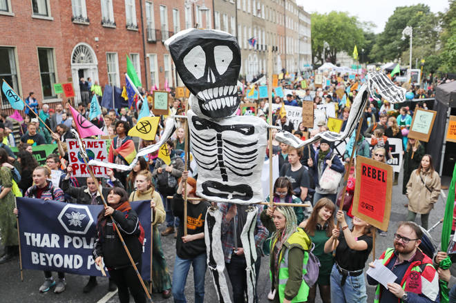 Extinction Rebellion protestors line the streets