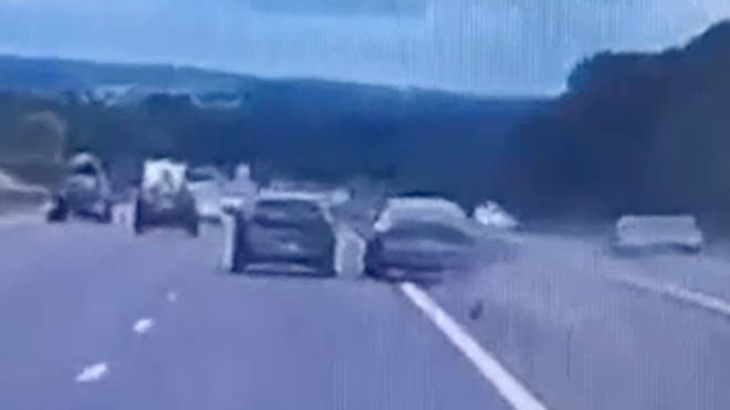 Impatient Audi driver overtakes a car by swerving into the central reservation