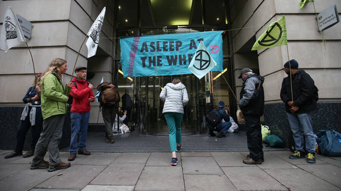 Extinction Rebellion protesters glue themselves to Government buildings