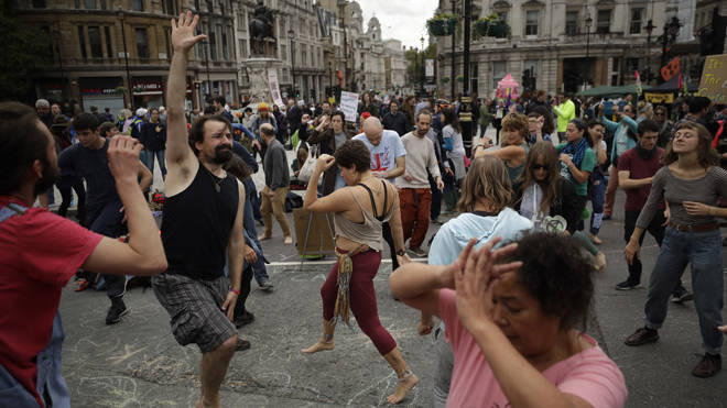 Extinction Rebellion protesters dance in Trafalgar Square