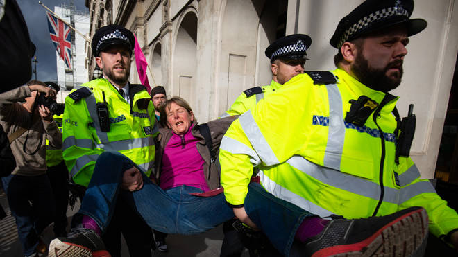 Officers were seen picking up activists to remove them