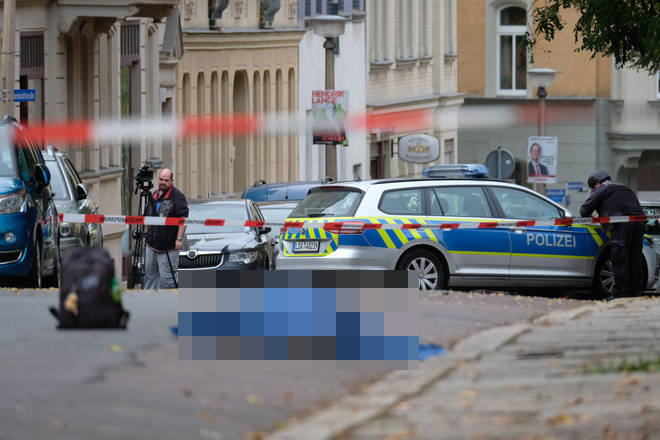 Police at the scene in Halle, Germany, after two people were killed
