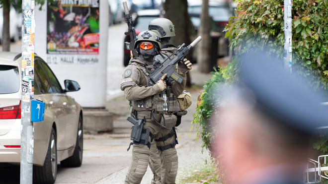 Armed officers in the immediate aftermath of the shooting