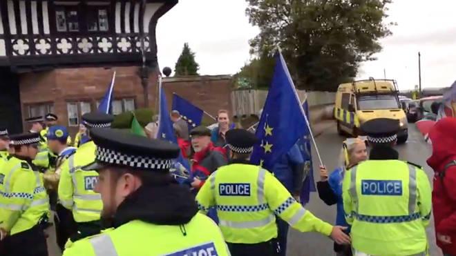 Police kept demonstrators away from the Prime Minister's motorcade